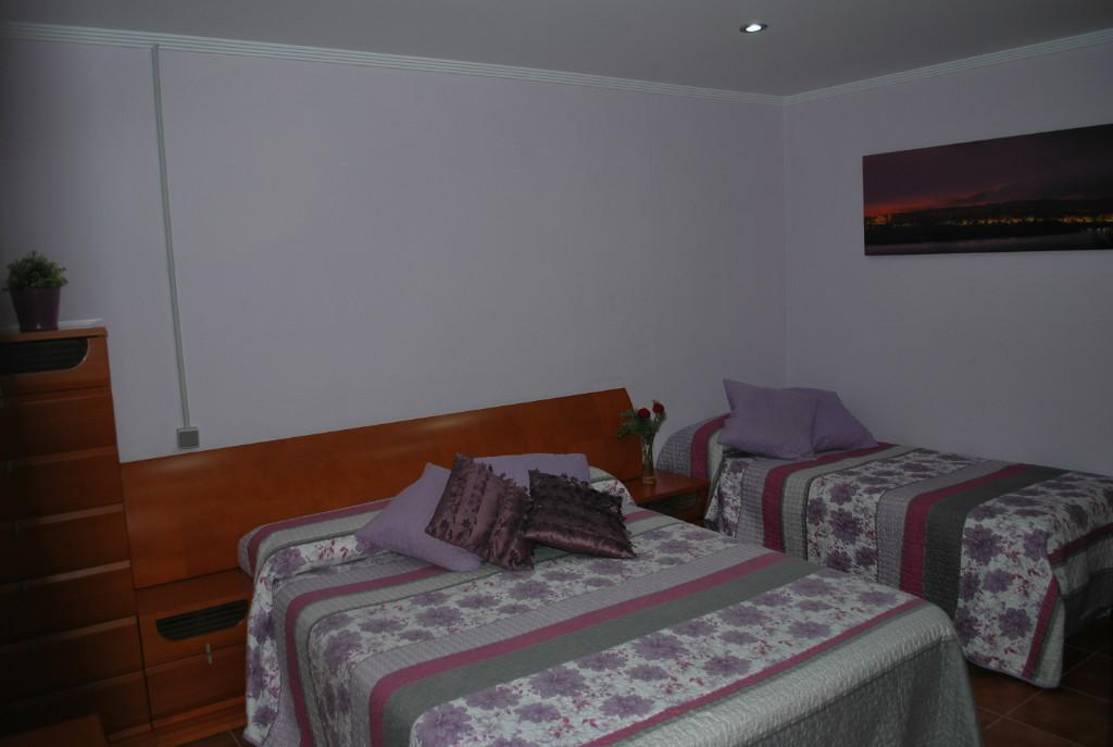 Three single beds room